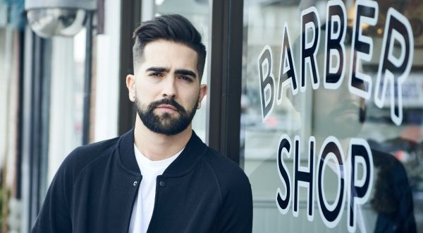 Bearded Man in Front of Barber Shop